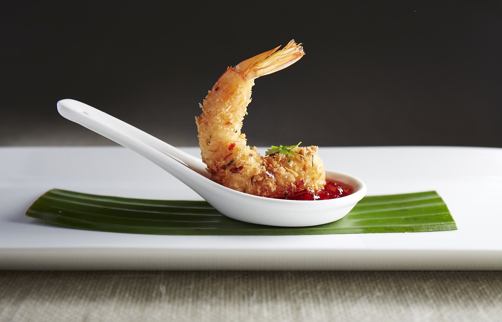 coconut and lime leaf crusted tiger prawns with chili sambal